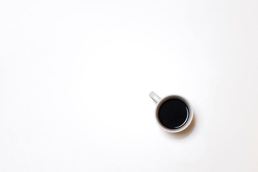 Cup of coffee on a white table